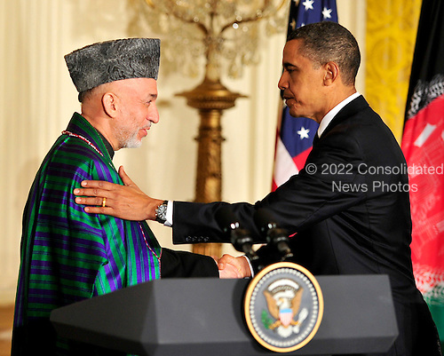 United States President Barack Obama, right, shakes hands with President Hamid Karzai of Afghanistan, left, as they conclude a joint press conference in the East Room of the White House in Washington, DC on Wednesday, May 12, 2010..Credit: Ron Sachs / CNP