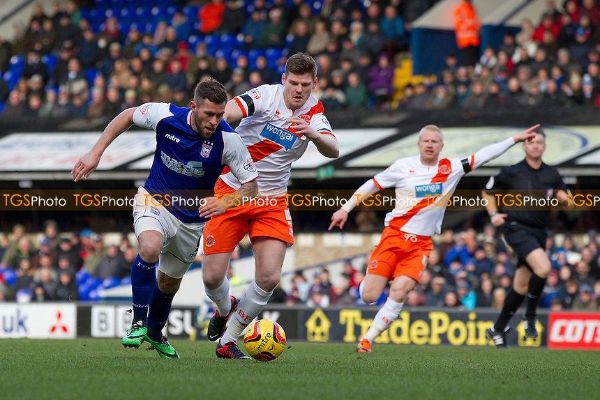 Daryl Murphy of Ipswich Town looks to get clear of Gary MacKenzie of Blackpool - Ipswich Town vs Blackpool - Sky Bet Championship Football at Portman Road, Ipswich, Suffolk - 15/02/14 - MANDATORY CREDIT: Ray Lawrence/TGSPHOTO - Self billing applies where appropriate - 0845 094 6026 - contact@tgsphoto.co.uk - NO UNPAID USE