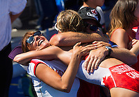 24 JUL 2014 - GLASGOW, GBR - Kirsten Sweetland (CAN) from Canada celebrates winning the silver medal at the elite women's 2014 Commonwealth Games triathlon in Strathclyde Country Park, in Glasgow, Scotland with supporters (PHOTO COPYRIGHT &copy; 2014 NIGEL FARROW, ALL RIGHTS RESERVED)<br /> *******************************<br /> COMMONWEALTH GAMES <br /> FEDERATION USAGE <br /> RULES APPLY<br /> *******************************
