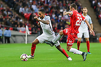 Theo Walcott (Arsenal) of England evades the challenge from Alex Muscat of Malta during the FIFA World Cup qualifying match between England and Malta at Wembley Stadium, London, England on 8 October 2016. Photo by David Horn / PRiME Media Images.