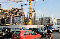 ANGOLA Luanda, the capital is one of the expensive real estate markets worldwide, construction site of new office tower Breve Aqui in the center, portuguese angolian Somague Engenharia Angola, S.A. / ANGOLA Luanda, die Hauptstadt ist einer der teuersten Immobilienplaetze weltweit, Bau neuer Buerotower, Baufirma Mischkonzern Somague Engenharia Angola, S.A., eine Tochter der portugiesischen Somague