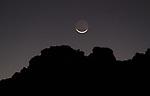 Crescent Moon over June Lake mountain ridge.