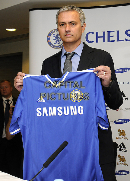 Jose Mourinho at Press Conference to officially unveil him as returning as Manager of Chelsea F.C, Chelsea Football Club, London, England.<br /> June 10th 2013<br /> half length blue top uniform samsung black suit blue shirt grey gray tie<br /> CAP/PP/BK<br /> &copy;Bob Kent/PP/Capital Pictures