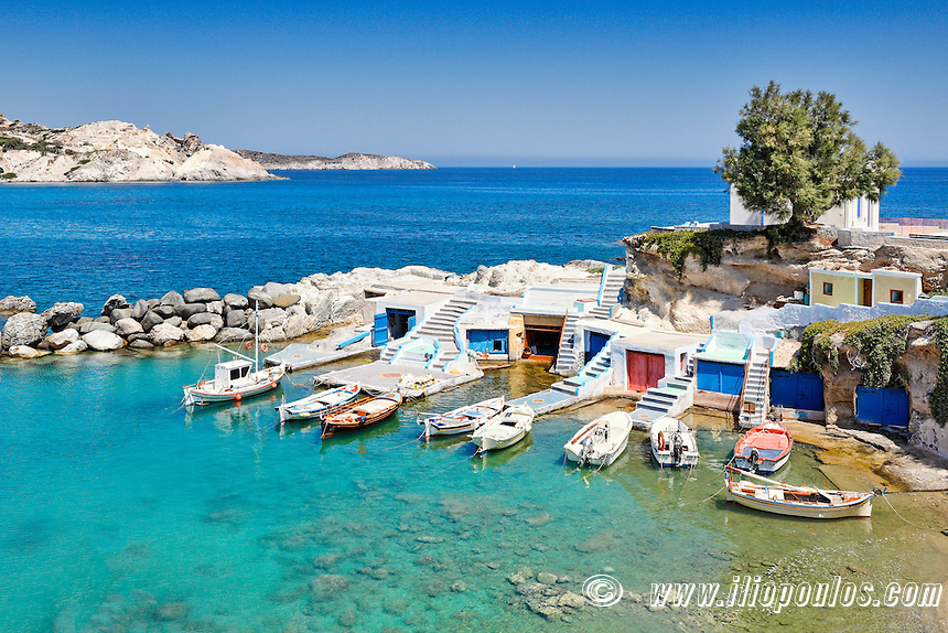 "Traditional fishermen houses with the impressive boat shelters, also known as ""syrmata"" in Mandrakia of Milos, Greece"
