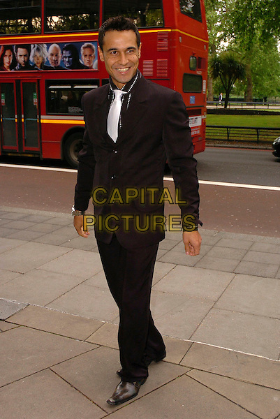 CHICO SLIMANI.The Ivor Novello Awards at Grosvenor House, Park Lane, London, UK..May 25th, 2006.Ref: CAN.full length black suit .www.capitalpictures.com.sales@capitalpictures.com.©Capital Pictures