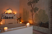 Romantic candelight transforms this contemporary bathroom