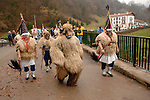 "A group of ""Joaldun"" march carrying sheep furs and big cowbells on their backs on January 30th, 2006 at the village of Ituren, Basque Country. Joaldun groups perform an ancient traditional carnival at the villages of Ituren and Zubieta making sound their cowbells in order to wake up the earth, to ask for a good new year, a good harvest and also to keep away the bad spirits. (Ander Gillenea / Bostok Photo)"