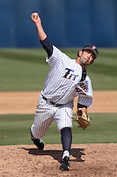 Dimitri DeLaFuentes #44 of the Cal State Fullerton Titans pitches against the TCU Horned Frogs at Goodwin Field on February 26, 2012 in Fullerton,California. Fullerton defeated TCU 11-10.(Larry Goren/Four Seam Images)
