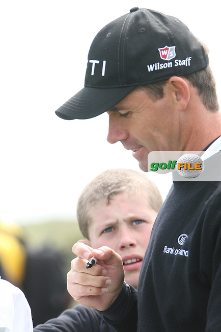 Padraig Harrington signs autographs at the Irish Open in Co.Louth Golf Club,  Baltray...Photo NEWSFILE/Jenny Matthews.(Photo credit should read Jenny Matthews/NEWSFILE)....This Picture has been sent you under the condtions enclosed by:.Newsfile Ltd..The Studio,.Millmount Abbey,.Drogheda,.Co Meath..Ireland..Tel: +353(0)41-9871240.Fax: +353(0)41-9871260.GSM: +353(0)86-2500958.email: pictures@newsfile.ie.www.newsfile.ie.FTP: 193.120.102.198.