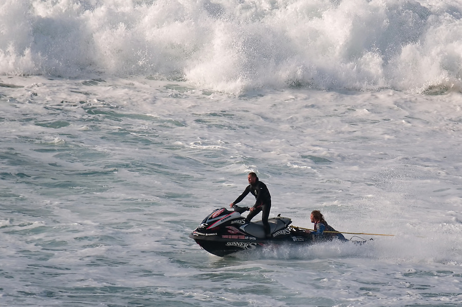 Surfer Ben Skinner being collected by his tow in partner at The Cribbar, Newquay, on October 30th 2011 #02. Cornwall's legendary big wave only occurs under precise conditions of a huge swell, a very long swell period, a particular swell direction, and a southeast wind, meaning that it only appears 2 or 3 times a year.
