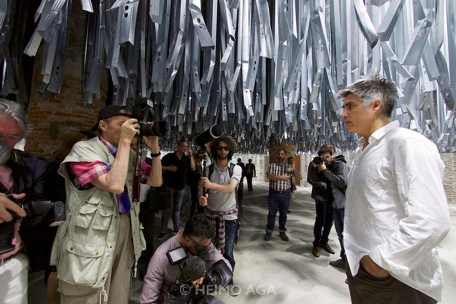 Venice, Italy - 15th Architecture Biennale 2016, &quot;Reporting from the Front&quot;.<br /> Arsenale.<br /> Curator Alejandro Aravena (white shirt) in his Curator's Project &quot;The Making of Reporting from the Front&quot;.