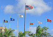 Flags flying over the Naval Visitor's Center in Pearl Harbor, Hawaii on Saturday, February 23, 2013.  Flags from left to right: United States Navy,  U.S. Air Force, U.S. Coast Guard, U.S. Flag, State of Hawaii, U.S. Army, and U.S. Marine Corps..Credit: Ron Sachs / CNP