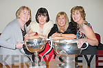 PROUD: Breda Murphy, Phylis O'Herlihy,Trish Whooley and Mona McCarthyy keeping a good grip on the Sam Maguire and the League Cup on Friday night at the Kerry Corkmans association dinner in Ballyroe Heights Hotel, Tralee...