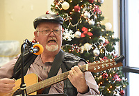 NWA Democrat-Gazette/FLIP PUTTHOFF <br /> SONGS OF THE SEASON<br /> Al Blair sings Tuesday Dec. 4 2018 with the Old Town String Band at the Billy V. Hall Senior Activity and Wellness Center in Gravette. The band features musicians on guitar, mandolin, fiddle, ukelele, bass and more. They play at the Gravette senior center at 10 a.m. the first, second and third Tuesday of each month