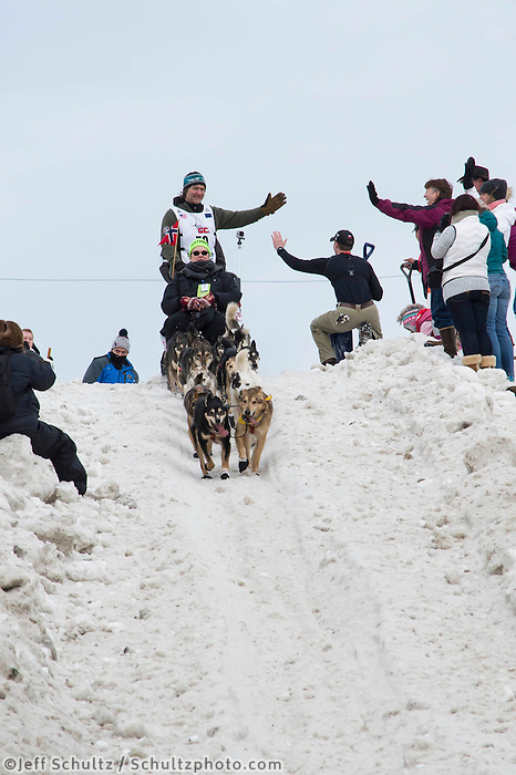 Geir Idar Hjelvik and team run past spectators on the bike/ski trail with an Iditarider in the basket during the Anchorage, Alaska ceremonial start on Saturday, March 5th during the 2016 Iditarod race. Photo by O'Hara Shipe/SchultzPhoto.com