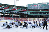The Providence College Friars stretch at center ice. -  - The participating teams in Hockey East's first doubleheader during Frozen Fenway practiced on January 3, 2014 at Fenway Park in Boston, Massachusetts.