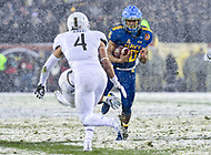 PHILADELPHIA, PA - DEC 9, 2017: Army Black Knights defensive back Max Regan (4) comes in to tackle Navy Midshipmen Quarterback Malcolm Perry (10) in the hole during game between Army and Navy at Lincoln Financial Field Philadelphia, PA. Army defeated Navy 14-13 to win the Commander in Chief Cup. (Photo by Phil Peters/Media Images International)