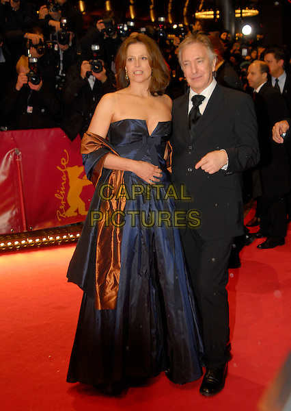 "SIGOURNEY WEAVER & ALAN RICKMAN.Premiere of ""Snow Cake"" at the 56th Berlin (Berlinale) Film Festival, Berlin, Germany..February 19th, 2006.Ref: KRA.full length blue brown strapless satin dress sash black suit .www.capitalpictures.com.sales@capitalpictures.com.©Capital Pictures"