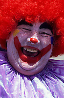 Portrait of a laughing  american clown with reed hair