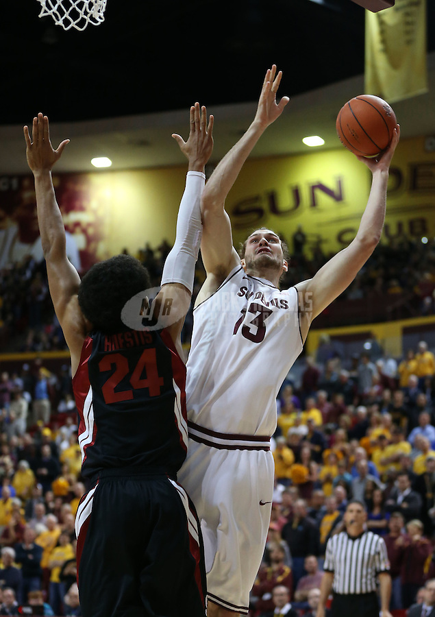 Feb. 9, 2013; Tempe, AZ, USA: Arizona State Sun Devils center Jordan Bachynski (13) drives to the basket in the first half against the Stanford Cardinal at the Wells Fargo Arena. Mandatory Credit: Mark J. Rebilas-