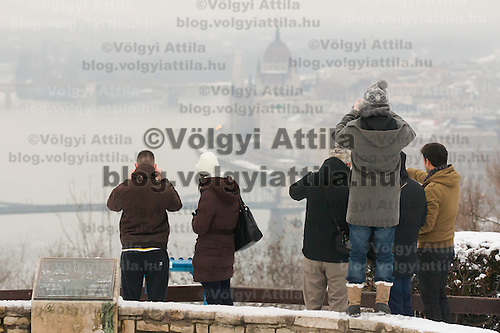 Tourists enjoy the view of the city center from a hill top in Budapest, Hungary on January 19, 2013. ATTILA VOLGYI