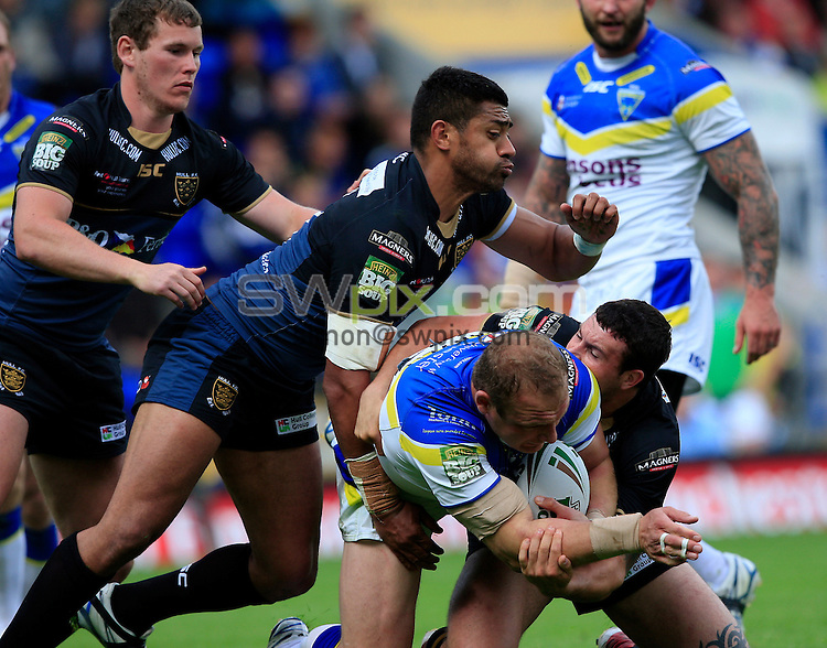 PICTURE BY CHRIS MANGNALL /SWPIX.COM...Rugby League - Super League  - Warrington Wolves v Hull FC - Halliwell Jones Stadium, Warrington, England  - 24/06/12... Warrington's Gareth Carvell  tackled by Hull's Willie Manu and Jay Pitts