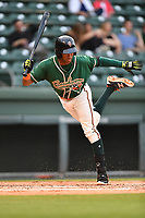 Shortstop Garvis Lara (28) of the Greensboro Grasshoppers bats in a game against the Greenville Drive on Tuesday, April 25, 2017, at Fluor Field at the West End in Greenville, South Carolina. Greenville won, 5-1. (Tom Priddy/Four Seam Images)