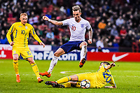 Norwich City's forward James Maddison (10) for England U21's  jumps over FC Shakhtar Donetsk's midfielder Oleksandr Pikhalyonok (20) for Ukraine U21's  tackle during the International Euro U21 Qualification match between England U21 and Ukraine U21 at Bramall Lane, Sheffield, England on 27 March 2018. Photo by Stephen Buckley / PRiME Media Images.