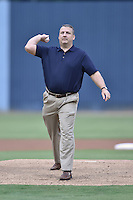 South Atlantic League President Eric Krupa delivers the first pitch before a game between the Hagerstown Suns and the Asheville Tourists at McCormick Field on September 9, 2014 in Asheville, North Carolina. The Suns defeated the Tourists 4-3. (Tony Farlow/Four Seam Images)