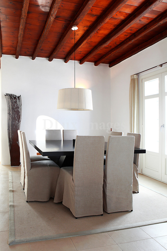 traditional dining room with contemporary furniture