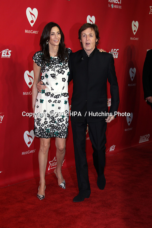 vLOS ANGELES - FEB 10:  Nancy Shevell, Paul McCartney arrives at the 2012 MusiCares Gala honoring Paul McCartney at LA Convention Center on February 10, 2012 in Los Angeles, CA