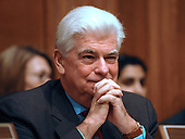 Washington, D.C. - January 8, 2009 -- United States Senator Christopher Dodd (Democrat of Connecticut) smiles as he listens to the opening remarks of former United States Senator Tom Daschle (Democrat of South Dakota) who testified before the United States Senate Committee on Health, Labor, Education, and Pensions on his nomination to be Secretary of Health and Human Services in Washington, D.C. on Thursday, January 8, 2009..Credit: Ron Sachs / CNP