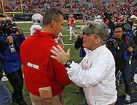 Ohio State head coach Urban Meyer and Illinois head coach Tim Beckman  meet at  midfield after the Buckeyes 60-35 victory at Memorial Stadium in Champaign, Illinois on November 16, 2013.  (Chris Russell/Dispatch Photo)