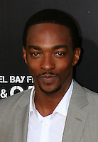 """Anthony Mackie.  Celebrities gathered at The TCL Chinese Theatre in Hollywood to attend the Los Angeles premiere of Paramount Picture's  PAIN & GAIN on April 22, 2013.<br /> Cast members and filmmakers attending include: Mark Wahlberg (Daniel Lugo), Dwayne Johnson (Paul Doyle), Michael Bay (Director), Anthony Mackie (Adrian Doorbal), Rebel Wilson (Robin Peck), Ed Harris (Ed Du Bois), Tony Shalhoub (Victor Kershaw), Rob Corddry (John Mese), Ken Jeong (Jonny Wu), Bar Paly (Sorina Luminita), Christopher Markus (Screenwriter), Stephen McFeely (Screenwriter), Donald DeLine (Producer)<br /> ABOUT PAIN & GAIN: <br /> From acclaimed director Michael Bay comes """"Pain & Gain,"""" a new action comedy starring Mark Wahlberg, Dwayne Johnson and Anthony Mackie. Based on the unbelievable true story of a group of personal trainers in 1990s Miami who, in pursuit of the American Dream, get caught up in a criminal enterprise that goes horribly wrong. Release Date:  April 26, 2013. Photo by Hilda Lazarte/ Unimedia/ DyD Fotografos"""