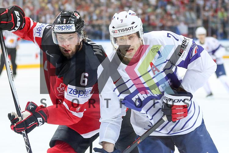 Frankreichs Trielle, Yorick (Nr.7) vor dem Tor im Zweikampf mit Canadas Muzzin, Jake (Nr.6) im Spiel IIHF WC15 France vs Canada.<br /> <br /> Foto &copy; P-I-X.org *** Foto ist honorarpflichtig! *** Auf Anfrage in hoeherer Qualitaet/Aufloesung. Belegexemplar erbeten. Veroeffentlichung ausschliesslich fuer journalistisch-publizistische Zwecke. For editorial use only.