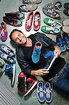 Laurent Tourma with some of his sneakers
