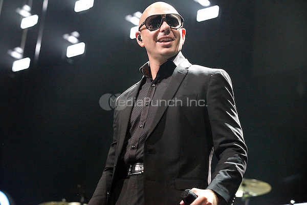 PHILADELPHIA, PA - DECEMBER 4:  Pitbull performs onstage during Q102's Jingle Ball 2013 presented by Bernie Robbins Jewelers in Philadelphia, Pa on December 4, 2013   © Star Shooter / MediaPunch Inc