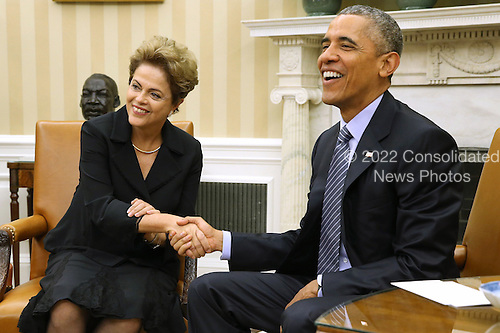 Brazilian President Dilma Rousseff (L) and U.S. President Barack Obama pose for photographs in the Oval Office at the White House June 30, 2015 in Washington, DC. Rousseff and Obama held meetings and a joint press conference almost two years after Rousseff accepted but then skipped an invitation to the White House due to revelations from former NSA contractor Edward Snowden that the U.S. had spied on Rousseff and other Brazilians.  <br /> Credit: Chip Somodevilla / Pool via CNP