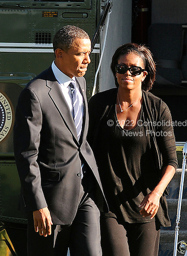 """United States President Barack Obama and First Lady Michelle Obama arrive at the White House in Washington, DC, Wednesday, September 8, 2010. The President was traveling to Cleveland, Ohio to deliver remarks on the economy at Cuyahoga Community College West Campus and the First Lady attended a """"Let's Move"""" event in Louisiana..Credit: Olivier Douliery / Pool via CNP"""