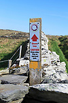 Coastal footpath and sign on cliff path, Cape Clear Island, County Cork, Ireland, Irish Republic