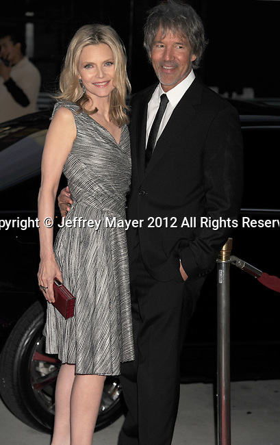 LOS ANGELES, CA - JUNE 15: Michelle Pfeiffer and David E. Kelley  arrive at the 2012 Los Angeles Film Festival premiere of 'People Like Us' at Regal Cinemas L.A. LIVE Stadium 14 on June 15, 2012 in Los Angeles, California.