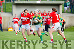 Bernie Breen Kerry protects the ball as she powers past Cork's Rena Buckley and Deirdre O'Reilly during their clash in the TG4 Munster Senior Championship in Macroom on Friday evening