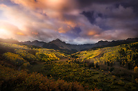 Mount Sneffels and golden aspen trees at sunset. Ouray, CO