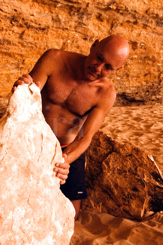 GREG VOELM with stone in REDWALL CAVERN is a large cave found at mile 33 along the Colorado River - GRAND CANYON,  ARIZONA..