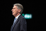 © Joel Goodman - 07973 332324 . No syndication permitted . 29/09/2013 . Manchester , UK . PHILIP HAMMOND addresses the conference . Day 1 of the Conservative Party Conference at Manchester Central . Photo credit : Joel Goodman