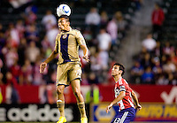 Philadelphia Union midfielder Michael Orozco (16) heads a ball over CD Chivas USA's midfielder Jonathan Bornstein (13). The Philadelphia Union and CD Chivas USA played to 1-1 draw at Home Depot Center stadium in Carson, California on Saturday evening July 3, 2010..