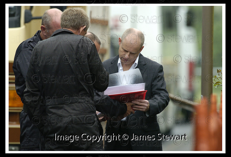 04/06/2007       Copyright Pic: James Stewart.File Name : sct_jspa09_tobin_house_0406.POLICE OFFICERS CHECK PLANS BEFORE ENTERING THE FORMER HOUSE OF PETER TOBIN IN ROBERTSON AVENUE, BATHGATE.......James Stewart Photo Agency 19 Carronlea Drive, Falkirk. FK2 8DN      Vat Reg No. 607 6932 25.Office     : +44 (0)1324 570906     .Mobile   : +44 (0)7721 416997.Fax         : +44 (0)1324 570906.E-mail  :  jim@jspa.co.uk.If you require further information then contact Jim Stewart on any of the numbers above.........