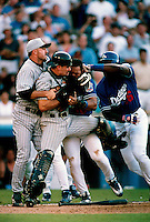 Jason Kendall of the Pittsburgh Pirates fights with Gary Sheffield of the Los Angeles Dodgers during a Major League Baseball game at Dodger Stadium during the 1998 season in Los Angeles, California. (Larry Goren/Four Seam Images)
