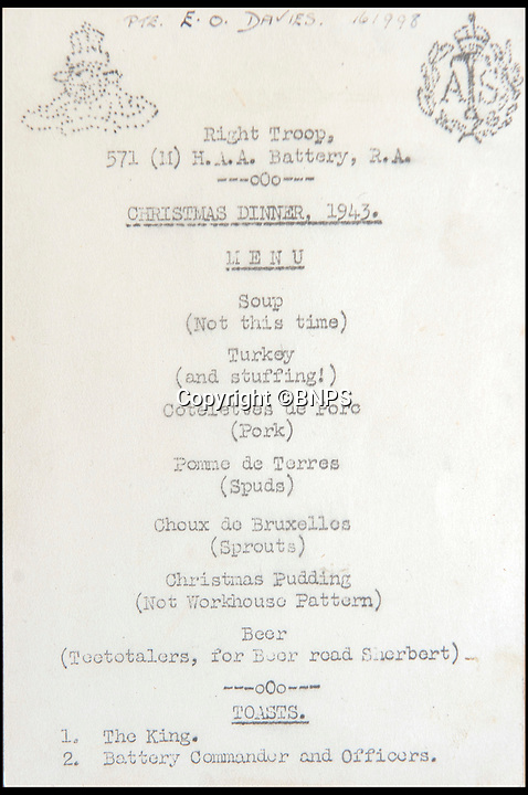 BNPS.co.uk (01202 558833)<br /> Pic: BNPS<br /> <br /> A Christmas Dinner menu from 1943.<br /> <br /> Haunting photos which capture the trail of devastation left in the wake of the Dunkirk evacuation have been unearthed after 77 years.<br /> <br /> The poignant pictures were taken soon after 330,000 Allied troops had been rescued from the beaches by an armada of little ships having been defeated by the Germans.<br /> <br /> The epic operation is about to be the subject of the new Hollywood blockbuster movie 'Dunkirk' will stars Tom Hardy and Harry Styles and is die for release on July 21.<br /> <br /> The black and white snaps show German soldiers surveying the wreckage which included destroyed ships and large military trucks lying in the surf.<br /> <br /> They are being sold by Duke's Auctioneers.