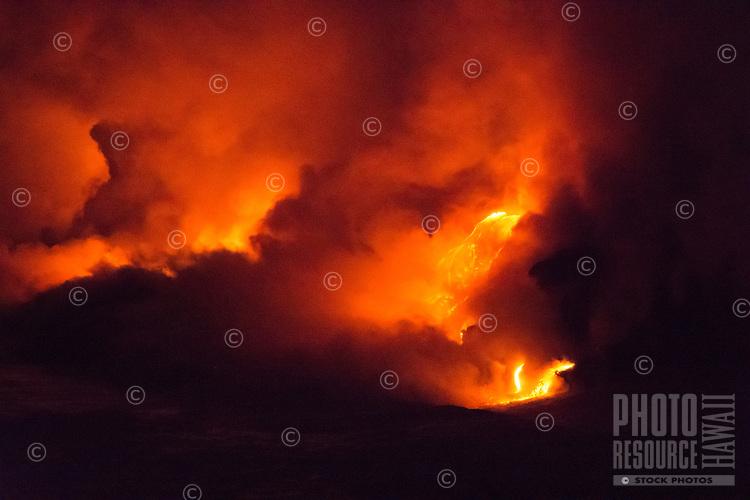 Lava from Kilauea volcano as it flows into the sea near Kalapana on the Big Island of Hawai'i. The Goddess Pele tells many stories through these beautifully shaped flows.